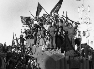 Anarchist militia from the National Confederation of Labour wave their flags and rifles for the camera in Barcelona during the Spanish Civil War. ca. 1937 Barcelona, Spain